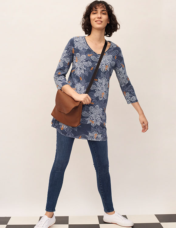 bag and floral tunic